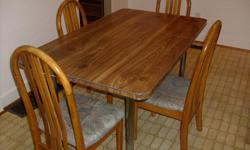 Kitchen table and four chairs Table 60 inches x 36 inches with leaf in 48 inches x 36 inches with leaf out
