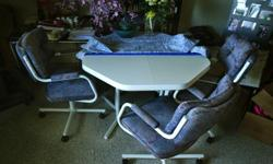 As you can see from the photo, this set is blue and white. The four chairs are all working well (swivel) and in good shape (no rips in the cloth). I'm selling this table and chair set and other furniture for my mom who just moved into an assisted living