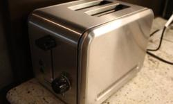 The KitchenAid 2 Slice Metal Toaster is an attractive and durable addition to any kitchen. Features: * 2-slice metal toaster offers 1-1/2-inch-wide slots with self-centering racks * Even-Heat system with sensor ensures consistent toasting; shade-control