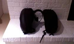 Black panniers / saddlebags. Stiff material (hardbags) with all clips and straps in perfect shape. Including a set of black leather riding boots (Size 13). I can deliver the goods if you're within the Niagara Falls area.