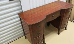 """Hard-wood kneehole desk - Excellent condition. (PEPPLERS fine furniture, from Hanover Ont.) Original antique drawer pulls on the 7 drawers. Great for home office or as makeup/dressing table. 46"""" long, 18.5 """" deep and 30"""" high. Asking Only $375"""