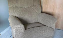 Rocking and fully reclinable LA-Z-Boy chair in fabric Condition: Excellent and very clean Still has the protective armrests and headrests covers Check out my other ads. Phone Anne 613-604-2607