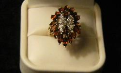 New Price!!!!   Ladies 10kt yellow gold ring Has 11 single cut diamonds, surrounded by 18 Marquise shaped garnets. Total weight 6.10gms   Appraised Nov 12 at $3,650.00 ( Have certified appraisal )   Perfect gift for Christmas!!!   Asking $950.00 or best