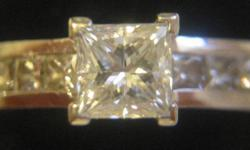 center stone is a princess cut .75ct, clarity V.S.1, colour F and cut is Very good....then theres eight .09ct princess cut, V.S.1 color F and the cut is very good. size 6   will trade or swap for gold jeweller   nino 905.687.0251