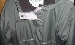 This Columbia jacket is very warm with elastic in waist at the back and wooly fleece inside.  Zip front, slash pockets, velcro closure at wrists, hood, pull tie at bottom hem to keep the cold out.    Good used condition.  Green/grey.   Columbia logo on