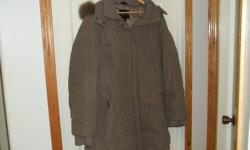 Sand (tan) colored 3/4 length jacket.  Storm cuffs and detachable hood.  Size L 14-16.  Clean and in excellent condition.  Nice stitching detail.   Very warm and comfortable.   No pets or smoking home.