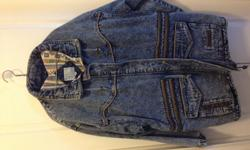 This longer length jean jacket has a tie waist, and leather inserts. Has deep front pockets. Ladies size 24W. Never been worn. Just have too many coats and need to downsize.
