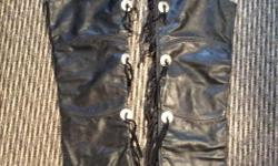 Size small to med. black leather motorcycle jacket and chaps. Fringed arms and legs. In excellent condition. Priced to sell fast