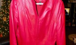 This is a brand new (never worn) Ladies Size Medium, Red, Danier Italian Leather Jacket.  It isa nicely fitted jacket with dual zippers for comfort in the car.  Color in picutre for some reason looks pinkish and does not accurately represent color, the