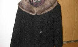have a pure lambs wool coat with mink collar. It is a size medium and is a short length coat. Made by Leeder furs in Toronto