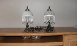 Two lamps in A-1 condition, 13 inches tall and comes with bulbs.  You can use them in any room.  $15.00 for the pair.