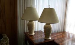 2 offwhite lamps with gold swirls.  1 hanging offwhite lamp with gold accents.  $75 for all.  Please contact by email.