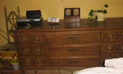 I have for sale a large 9 drawer dresser solid wood with a darker finish.It is a older piece but in very good shape.First picture is actual colour.It measures 71 long 19 wide and 33 high all in inches. To view call 519-337-2156 thanks