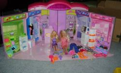 THIS LARGE BARBIE SET INCLUDES:   2 BARBIES ACESSERIES 2 BARBIE CARS IN GREAT CONDITION   LARGE MALL; FOUR STORES TO VISIT WITH YOUR BARBIE; STORE ACCESSERIES   FREE BARBIE BAG TO KEEP ALL YOUR BARBIE ACCESERIES IN.     AT THE STORE ALL OF THIS WOULD BE