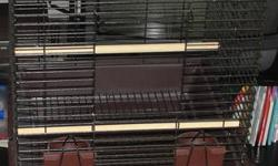 This cage is in mint condition, nice bronze color with brown bottom. Pull out tray for easy cleaning. Bar width just under an inch. Pick up only Oshawa Park Rd/401 area call Donna 289-481-1006