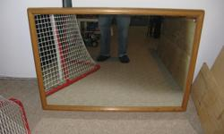 "Large quality mirror with solid wood frame. Measures 30 x 42"". Pickup in kanata and check out our other ads too."