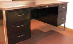 Large office desk, black metal frame and drawers (6), with wood style top.$40 or best offer. Also have filing cabinet (black) for sale - $40 or best offer
