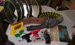 Race track has 4 loops, suspended bridge, log ride over water, rough road, 2 race cars, lap counter and lots of track.  Not all the pieces are shown in the picture, just the featured items.  We had it set up on a 4' x 8' table.  If you want, we can add