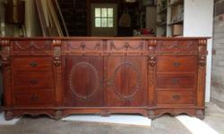 "Good condition, buffet side unit with hutch Cherry wood, carved with bevelled glass doors (one glass missing) small chip on one leg very good condition. Bottom unit 87""w x34""h x 20""d, top unit (hutch) 87""w x 52""h x 20""d. Overall height when stacked 86""h."