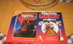 This is and awesome package for someone who wants to learn to play the electric guitar.   Brand new in the box.   Electric Guitar and Book and DVD   Box set includes 64 page full color book and 74 minute multi angle DVD   With key effects, practice