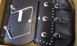 BRAND NEW ROADCHROME CLASSIS REAL LEATHER BAGS.BAGS WERE DESIGNED TO FIT HONDA VT1100 AERO 1998-2003.LOOKS LIKE THEY WOULDN'T BE TO HARD TO MOUNT TO OTHER BIKES.$250+TAXES,CAN DELIVER TO WINNIPEG.RETAIL ON THESE BAGS WAS $599.