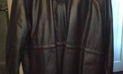 2x womans leather coat never worn from penningtions tags still on coat. asking $200 paid about $275