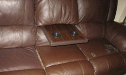 I am selling a leather couch of mine, it is a 3 seater, dark brown colour, and the middle portion can be switched into a table. The couch is less then 2 years old and is in great shape still, two of the seats recline as well. There is a few small tears in