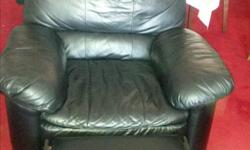 Black leather couch and chair. Chair and 2 ends of the couch recline. $300 or best offer. Phone number is long distance; may text to 403-360-4779.