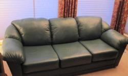Near mint condition green leather 3 seater couch and 2 seater love seat. Very comfortable! Selling because bought house fully furnished but already have our own furniture. Also, small white love seat like new. All couches were lightly used in previous