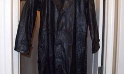 Full length Black Leather Overcoat. Size XL. Made by, Giovanni Navarre, Italian Stone Design. Style #GFTRXL Also comes with matching waist belt. Very nice coat and it has never been worn. New and unused still has tags on it. $75.00 obo