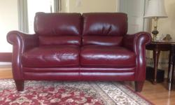 LEATHER LOVE SEAT. BERGUNDY IN COLOUR. PURCHASED FRLM LAZY BOY IN FEBRUARY 2012 FOR $2000.00. MOVED INTO SMALLER HOUSE AND REALLY DO NOT HAVE ROOM FOR IT. PERFECT CONDITION. NON SMOKING ADULT USERS. LENGTH: 62 inches. HEIGHT: 38 inches. DEPTH (front to