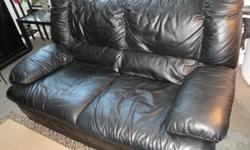 Black leather IKEA loveseat. Good condition, comes from a home with no smokers, pets or children. Very comfortable; low European styling. Pick-up only; downtown Toronto location. Selling to finance my film!