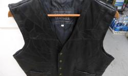 black leather vest size large made 0f leather pieces very nice ex cond.