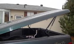 """LEER Fiberglass tonneau cover currently on a 2004 F150 ext cab 6'6"""" box may fit other trucks.  Carpeted inside, comes with all hardware and keys to lock. Located in Elliot lake will deliver to Sudbury Thanks"""