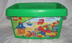 Hello, we are selling a set of 100 Lego Duplo bricks and a storage bin. The bricks are in good condition with some play wear including some scratches and a few minor marks. They are mostly basic bricks in basic colours, with a window brick; there are no
