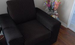 This brown arm chair with black stripes would make a great addition to your living room. You can get comfy and watch the game or read a great book.