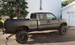 Make Chevrolet Model Silverado 2500HD Colour Black Trans Automatic Tuck has the LB7 first generation 6.6L Duramax Turbo Diesel V8 with 5-Speed Allison Automatic Transmission. Fully loaded for 2001, has leather front and rear with no rips, front centre