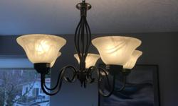 Traditional pendant light fixture with dark metal stem/arms and six white petal cups. All pieces in excellent working condition and all bulbs included. Selling due to dining room remodelling.
