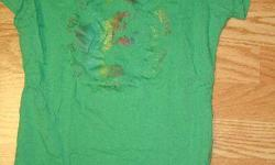I have a Like New Green T-Shirt Youth Size S-M for sale! This is in excellent condition and would look great in your home or to give as a gift. Comes from a non-smoking household. Do not miss out on this excellent opportunity to get this for a fraction of