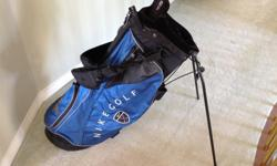 Like new... NIKE GOLF BAG....with built on n stand... Double over the shoulder heavily padded straps... Great color.. Nice light bag...for easy carrying