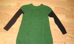 I have a Like New Sweater Green Black Woman Size M for sale! This is in excellent condition and would look great on you or to give as a gift. Comes from a non-smoking household. Do not miss out on this excellent opportunity to get this for a fraction of