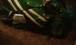 2008 green 49cc gas superbike with options, larger version of the pocket bike. working spedometer, disk brakes, front and rear suspension. all plastics, good shape, headlights taillights and turn signals but key broke so lights dont work but could be