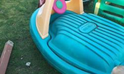 Great condition boat sandbox. No sand included. Sun faded but no cracks!