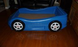 For Sale:  Little Tikes blue car bed.  Fits a crib-sized mattress; a great way to transition your little guy out of the crib and into a 'big boy' bed.    Easy to clean since it's all plastic!  I replaced the original thin base wood (that the matress sits