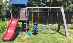 Gently used by one small child Retails for $1395 + tax at Toys R Us A backyard swing set with the features of large playground equipment! The Playcenter Playground features swings, a large kids sliding board, sandbox, cargo net and more. This stylish