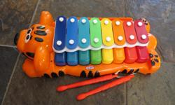 Hit the xylophone with included sticks or press the note keys below.