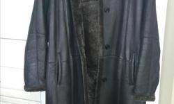 long black shearling coat with hood, size large (12-14), almost never worn, paid $1400 asking $700