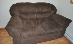 This transitional piece features soft, comfortable fabric upholstery, no sag spring seating and a durable wood frame.     Transitional style love seat     Color: dark brown     Soft wide corduroy fabric upholstery     Wood frame     no-sag spring seating