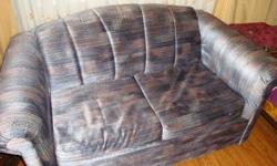"""- love seat with pull-out single size bed - multi-coloured grey/blue velour fabric - excellent condition - no tears, rips or stains - from pet and smoke-free senior's home - love seat measures 60""""x34""""28"""" (LDH), bed is 72""""x36"""" - buyer to arrange removal"""