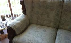 Love seat - neutral background with pastel flower design, wood on arms.  Excellent condition.  asking $250.  OBO